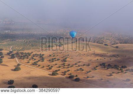 Alentejo, Portugal - August 27, 2020: Hot air balloon in the Alentejo region, above the fields. Portugal.