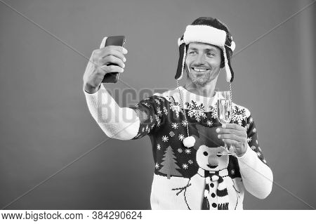 Party Selfie. Bearded Man Take Selfie With Smartphone. Happy Guy Smile To Selfie Camera In Mobile Ph