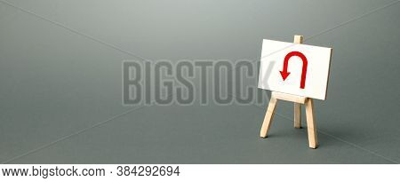 Easel With Red Arrow Turning Back. Tactical Retreat For Redeployment. Avoiding Problems, Reducing Ri