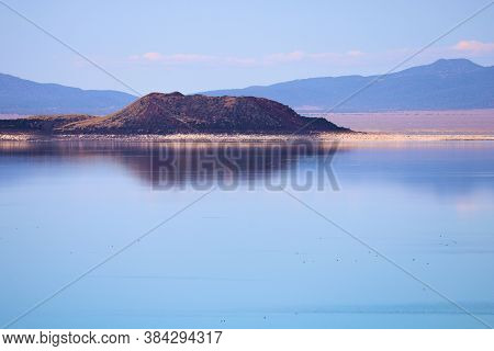 Volcanic Crater In The Middle Of Mono Lake, Ca Surrounded By The Arid Great Basin Desert Landscape