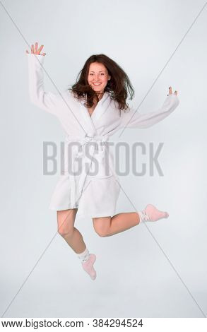 Beauty Salon For Your Relax. Pretty Woman Happy Jumping In Dressing Bathrobe. Sensual Woman After Be