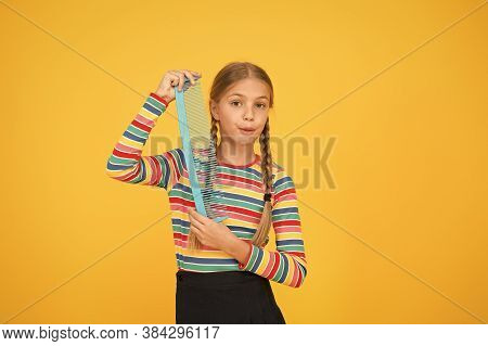 Shampoo Hair First Then Comb. Small Child Hold Comb Yellow Background. Wash Hair With Shampoo. Combi