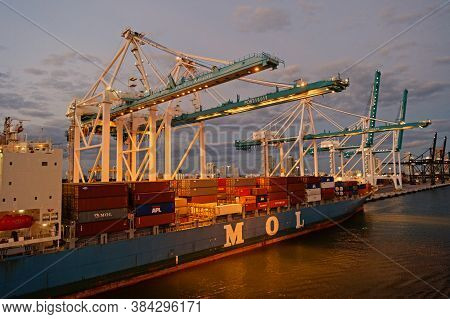 Miami, Usa - March 01, 2016: Mol Vessel In Evening Port. Container Vessel. Containership And Cranes