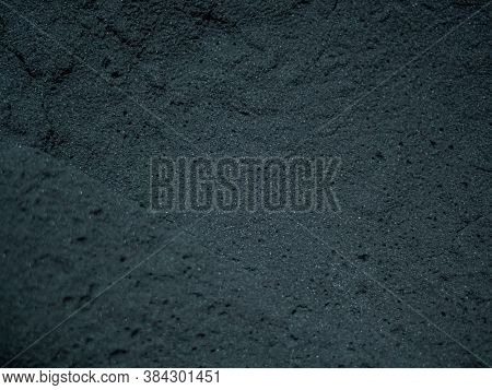 A Close Up Of A Black Coal Texture, Dark Coal Back, Blue Tint