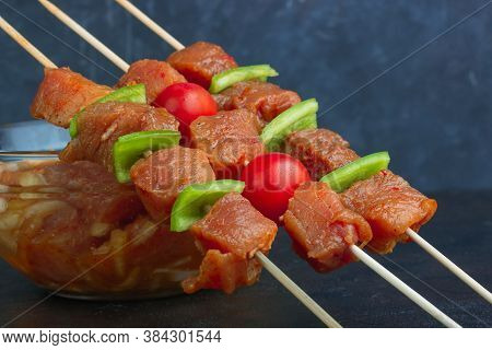 Marinated Meat On Skewers With Peppers And Cherry Tomatoes