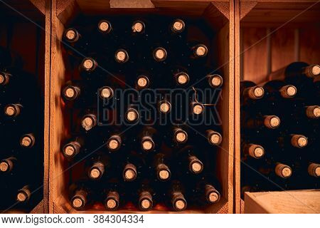 Wine Bottles With Corks Stored In Wooden Racks