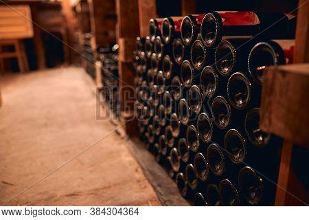 Bottles Of Wine Stored In Wine Cellar