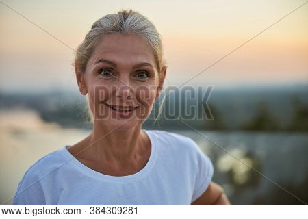 Cheerful Suntanned Blonde Woman Posing For The Camera