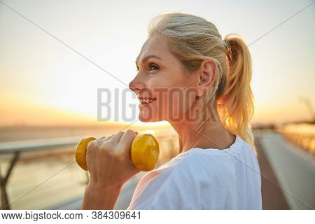 Sportswoman Gazing Into The Distance During The Workout