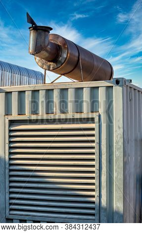 industrial container with metal blinds, and an exhaust, mobile power unit