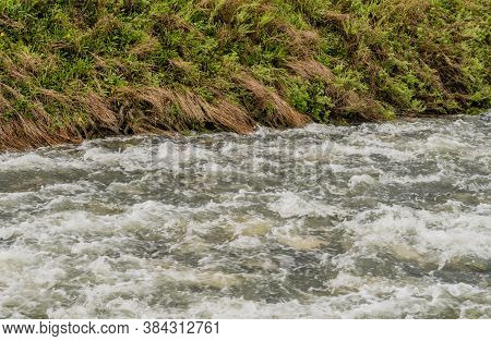 Closeup Of Water In River Surging After Torrential Monsoon Rains In South Korea.