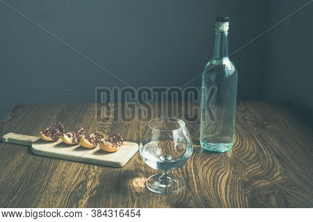 Glass And Bottle With Crystalline Liquor Like Vodka, Tequila Or Mezcal