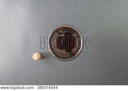 Top View Of Cork And Glass With Red Wine