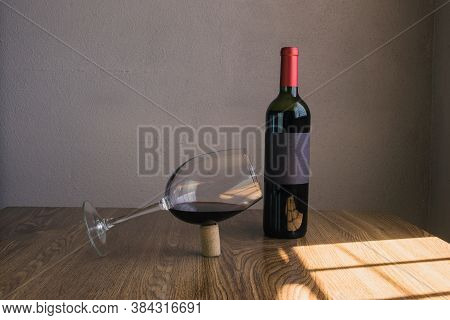Balanced Wine Glass In Cork Next To Wine Bottle Mockup