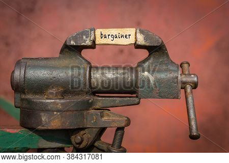 Concept Of Dealing With Problem. Vice Grip Tool Squeezing A Plank With The Word Bargainer