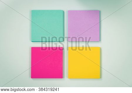 4 Color Stick Note Or Note Pad As Green,purple,pink,yellow On Modern Clean Creative Office Desk Or O