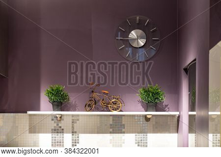 Modern Interior. Close-up Of Shelf With Decorative Flowers And Statuette.