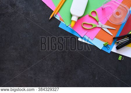 School Supplies On A Black Background. Back To School Concept.flat Lay Composition With School Stati