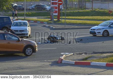 Saint Petersburg, Russia-may, 2020: A Motobike Crashed Into A Car A Motorcyclist Was Injured Police