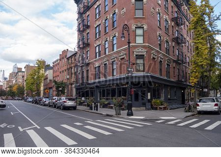 Manhattan New York City Building And Street With Curb Side Parking