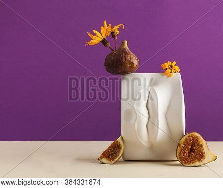 A Plaster Figure Of Lips With Fresh Figs And Flowers On It. Art Concept, Erotic Food. Copy Space.
