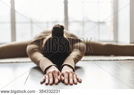Young Woman Practice Yoga At Home, Doing Upavishtha Konasana Posture. Fitness, Stretching, Flexibili