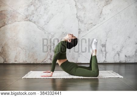 Portrait Of Young Attractive Woman Wearing Sportswear, Start Her Day Doing Stretching Practice, Doin