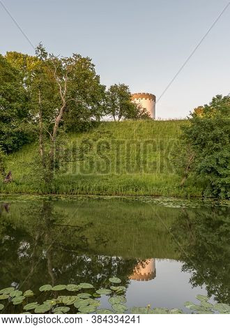 A Round Tower On The Top Of The City Walls Of Fredericia, Reflecting In The Rampart, Denmark, June 8