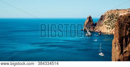 Yacht Floating On Water. Composition Of Nature. Summer Landscape. Sky And Ocean Panorama. Magnificen