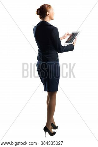 Portrait Of Young Woman Looking Upwards With Tablet Computer. Side View Of Confident Businesswoman I