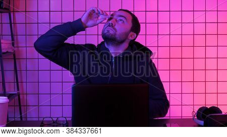 Young Gamer Taking Off Glasses Feels Eye Strain Tension Tired Of Computer And Uses Eye Drops.