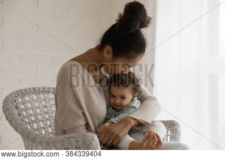 Loving Young Mixed Race Woman Kissing Little Adorable Baby Kid.