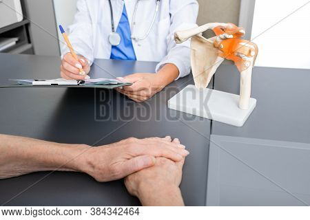 Rheumatologist And Senior Patient, Consultation. Recovery From A Clavicle Fracture