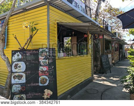 Badung Bali, Indonesia - September 26, 2019: A Row Of Small  Food Stalls Made Of Zinc Container At