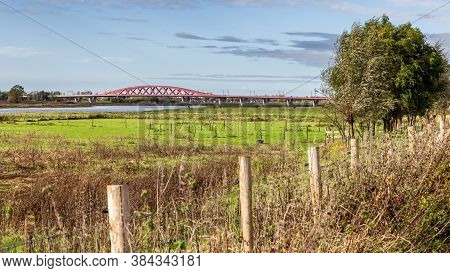 Scenic View Red Railroad Bridge Hanzeboog Over The Ijssel River At The Entrance Of Zwolle In The Net
