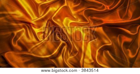 The texture of the fabric of the roughness of gold-colored satin for use as background poster