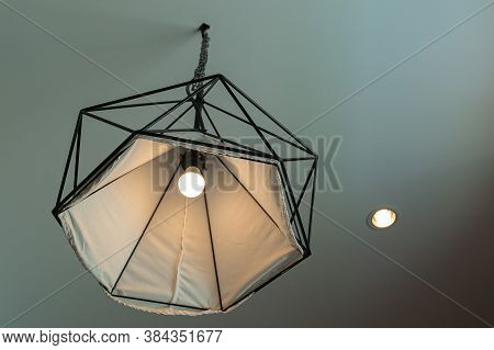Light Bulb And Lamp In Modern Style. Warm Tone Light Bulb Lamp. Lightbulb In Interior.