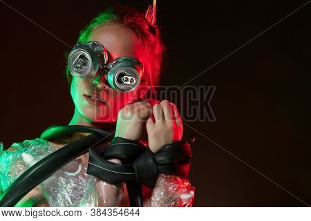 Portrait Of Upset Girl With Glasses Of Cans On Eyes. Young Woman Is Choking, Bounded, Wrapped, Cover