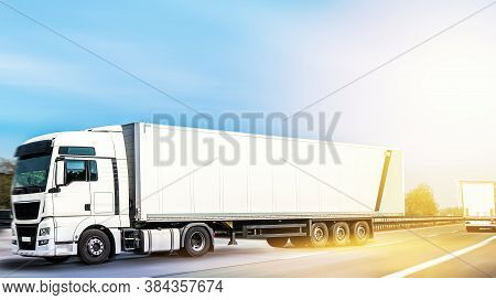 Large Truck And Trailer With Space For Text Traffic On A Rural Road Against The Sky . Motion Blurred