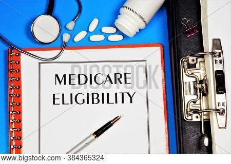 Medicare Eligibility-text Label In The Office Registrar's Folder. Insurance Program, Payment For Med