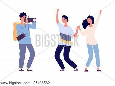 Couple And Photographer. Photo Session, Happy Young Man Woman Posing For Camera. Professional Camera