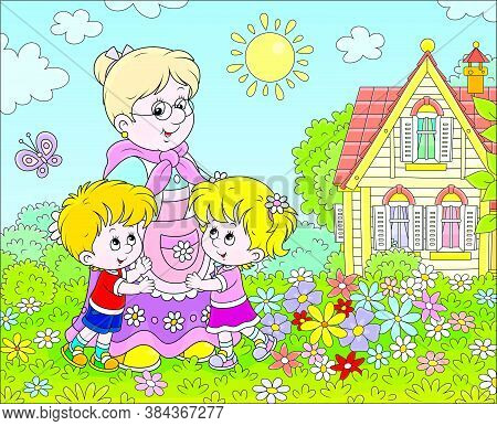 Granny And Her Little Grandchildren Smiling And Hugging Among Colorful Flowers On A Green Lawn In Fr