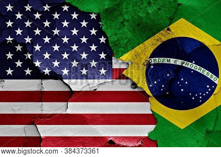 Flags Of United States And Brazil Painted On Cracked Wall