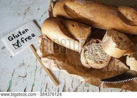 Whole And Sliced Bread / Loaf, Gluten-free, On A Light Background. Gluten Free Sign.