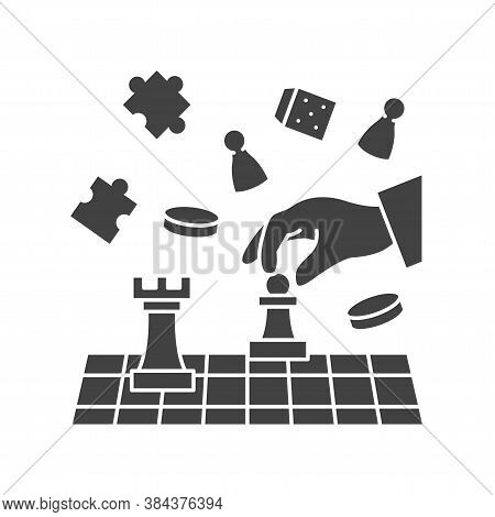 Board Game Of Chess Black Glyph Icon. Hand Holding Chess Figure. Home Leisure. Vector Isolated Illus