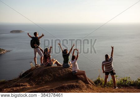 Five Happy Friends Are Having Fun And Enjoying Sunset At Sea View Point