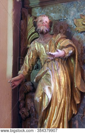 TABORSKO, CROATIA - SEPTEMBER 04, 2012: St. Matthew the Evangelist statue at the pulpit in the Church of the Assumption of the Virgin Mary in Taborsko, Croatia