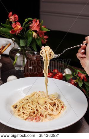 Appetizing Carbonara Paste With Chicken Improperly Wound On Fork. Spaghetti Inaccurately Hanging And