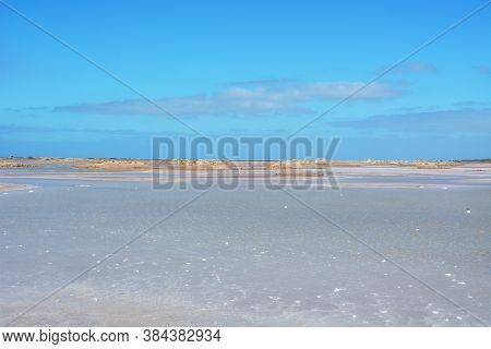 The Blue And White Colours Of The Porto Ingles Salt Pans In A Sunny Day