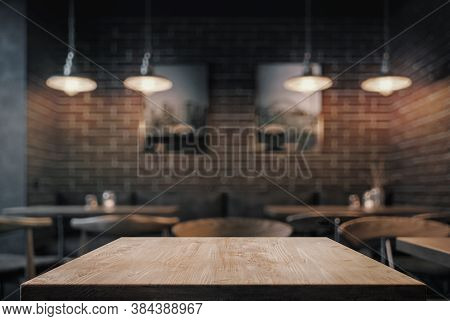 Empty Coffe Table At Night Over Defocused Background With Copy Space